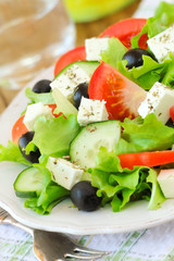 Greek salad with feta and fresh vegetables served on a plate
