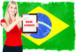 young woman with flag of brasil and tablet pc
