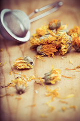 Dried Marigold Flowers with a tea strainer