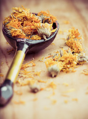 Dried Marigold Flowers in rustic spoon