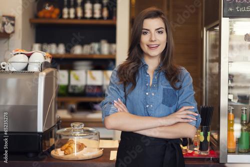 Portrait of friendly waitress at work
