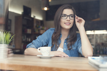 Portrait of beautiful woman at cafe