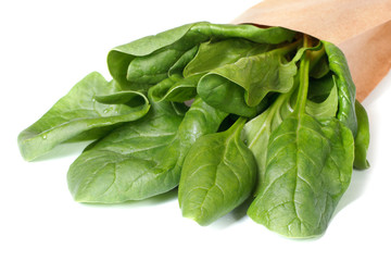 Spinach leaves in paper packing isolated on a white