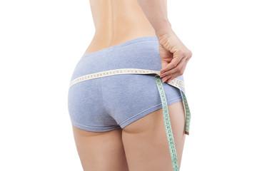 Measuring waistline.