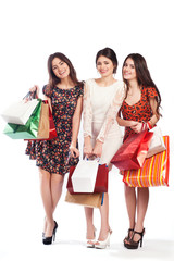 Group of happy pretty laughing girls with shopping bags