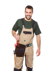 Portrait of smiling worker in brown uniform with tools
