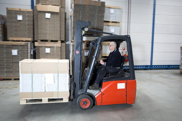 Forklift driving with a palet