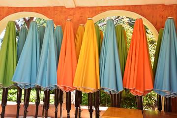 colorful parasols closed aligned Mexico