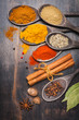 Spices and herbs on dark background.