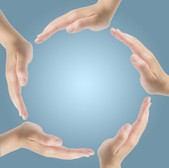 Group of hands forming a circle isolated on blue background