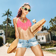 Girl in sunglasses with longboard
