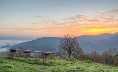 Sitting bench with sun rising