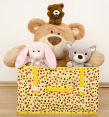 A box full of toys, three bears and a funny rabit