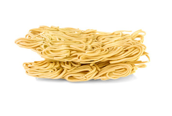 Dry egg noodles over a white background