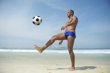 Athletic Young Brazilian Man Kicking Football Rio Beach
