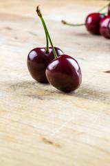 Two juicy healthy ripe red cherries
