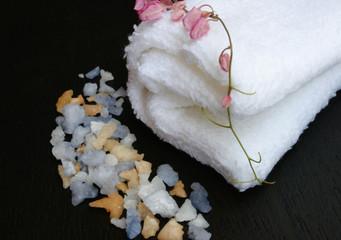 spa salt and white towel on black