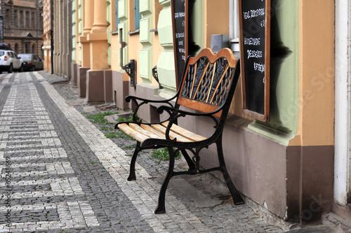 Staande foto Praag Bench near restaurant