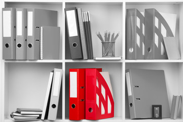 Concept of individuality.One color shelve with stationery among