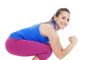 Beautiful woman exercising and looking very happy
