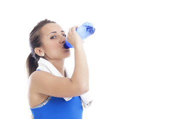 beautiful young sporty woman with a bottle of water