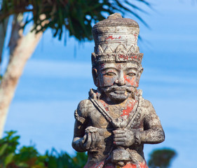 Balinese god on the background of the ocean. Indonesia, Bali
