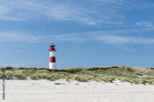 Lighthouse on dune horizontal - 65253267