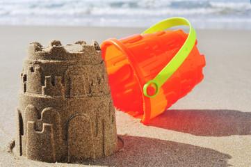 toy bucket sandcastle on the sand of a beach