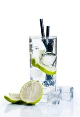Cocktail with ice and lime slice isolated