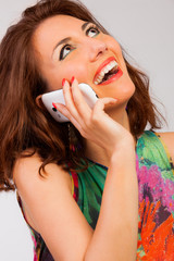 Young Woman Talking On Cell Phone and laughing
