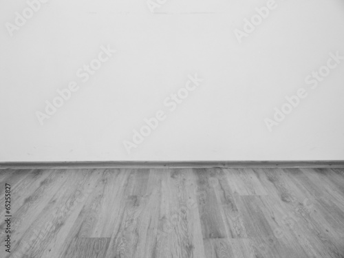 Poster room interior vintage with white brick wall and wood floor backg