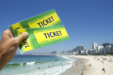 Hand Holding Brazil Tickets at Copacabana Beach Rio Brazil