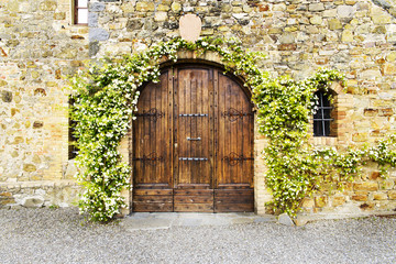 The arch door of an old tuscan villa