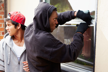Two Young Men Breaking Into House