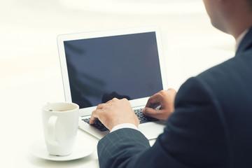Indian businessman using laptop