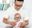 Father and baby with nerd glasses.