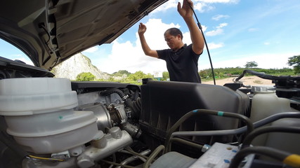 Man to check car engine before driving