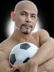 athlete smart man muscle footballer seriously with football