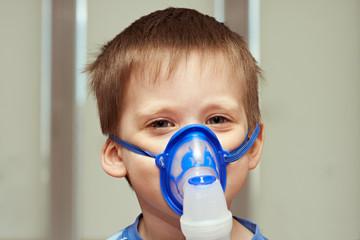 Little boyl using an inhaler