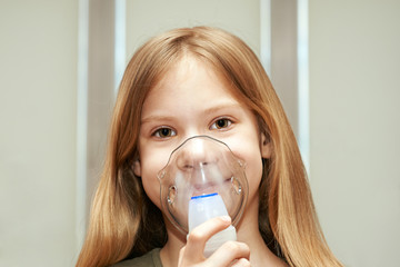 Little girl using an inhaler