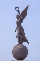 Goddess of victory Nike on sphere.