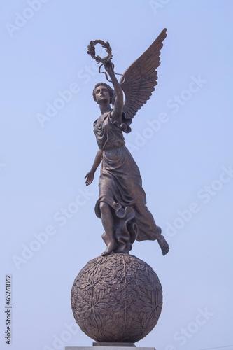 Leinwanddruck Bild Goddess of victory Nike on sphere.
