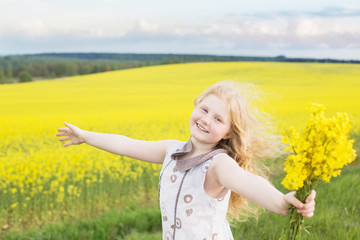 Cute funny girl on rape field