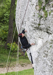 Man climbing rocky wall.