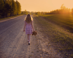 young girl walking away