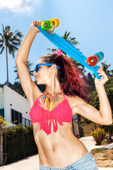 Girl in sunglasses with longboard