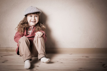 child sitting on the floor in room