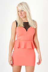 model in orange / coral peplum dress