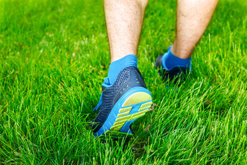 Closeup of a male runner standing - Fitness concept.