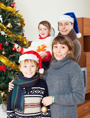 Happy family with Christmas tree